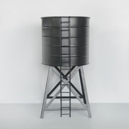 a plant pot designed as a water tower