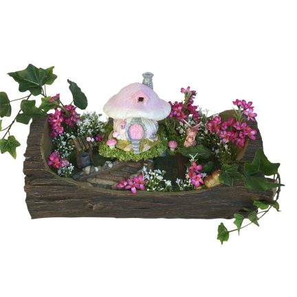 Fairy Garden log with display of plants and fairy house