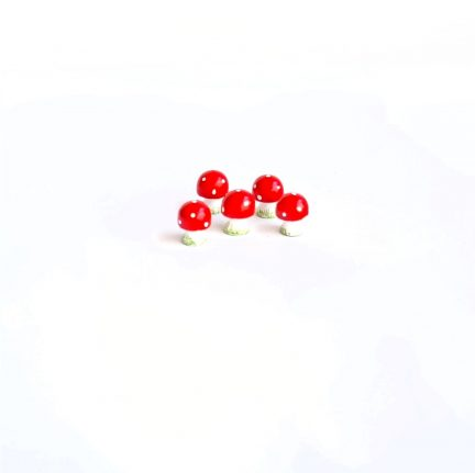 Miniature red toadstools
